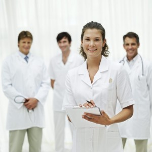 Female Nurse and a Group of Medical Personnel