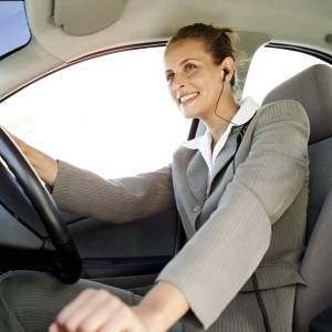 Woman Driving a Car and Wearing Earphones